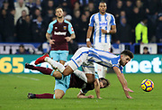 Huddersfield Town's Tommy Smith is fouled by Mark Noble of West Ham United during the Premier League match between Huddersfield Town and West Ham United at the John Smiths Stadium, Huddersfield, England on 13 January 2018. Photo by Paul Thompson.