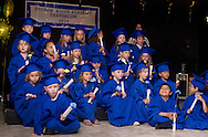 New Windsor, New York - Children gather on the stage for a group photograph after Hudson Hills Academy held its Primary School graduation ceremony on Wednesday, June 11, 2014. The children completed a Montessori program at the school. ©Tom Bushey / The Image Works