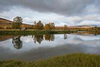 Reflection of trees in river delta at Bäverholmen along Kungsleden Trail, Lapland, Sweden