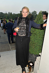 BAY GARNETT at a party hosed by the US Ambassador to the UK Matthew Barzun, his wife Brooke Barzun and editor of UK Vogue Alexandra Shulman in association with J Crew to celebrate London Fashion Week held at Winfield House, Regent's Park, London on 16th September 2014.