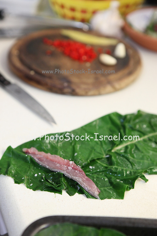 Mackerel fish fillet wrapped in chard leaves