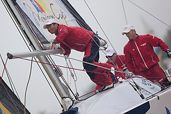 Kazuhiko Sofuku (YANMAR Racing) prepares to hoist the spinnaker during qualifying session 4 Monsoon Cup 2010. World Match Racing Tour, Kuala Terengganu, Malaysia. 4 December 2010. Photo: Subzero Images/WMRT
