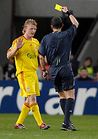 Photo: RIchard Lane.<br />PSV Eindhoven v Liverpool. UEFA Champions League, Quarter Final, 1st Leg. 03/04/2007. Liverpool's Dirk Kuyt is booked by referee, Bertrand Layec.