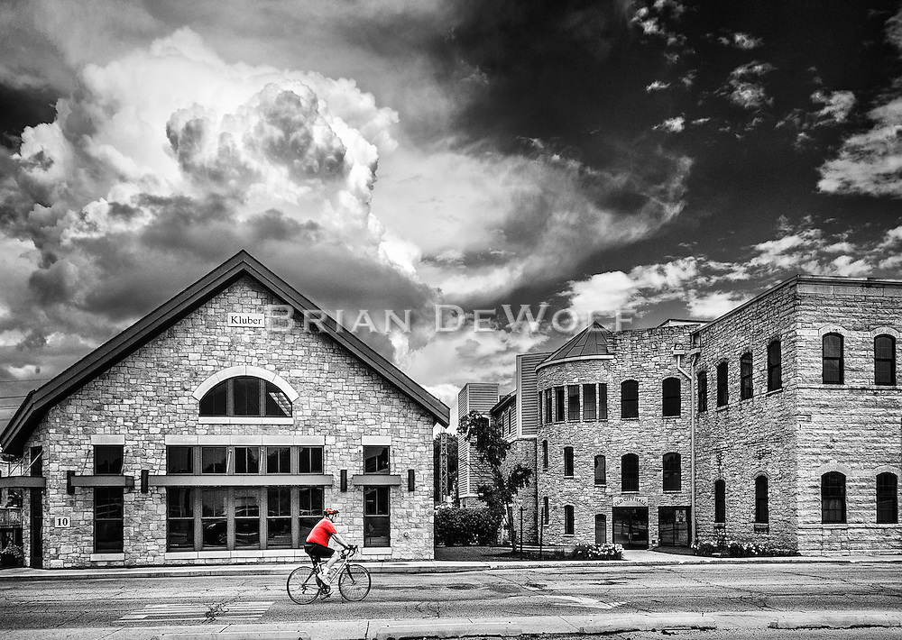 A good day for biking in Batavia, IL is about to be not so good as a thunder cloud lurks behind the building.
