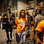 London, England, UK. 23rd August 2017. Hundreds attend Notting Hill Carnival 2017 Panorama kicks off on the Saturday 23rd August 2017 evening with a steel band music competition and more Caribbean-themed outdoor entertainment for all the family Panorama and pay respect Justice for Grenfell at Emslie Horniman Pleasance Park, Bosworth Road.