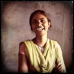 """iPhone portrait of Laali Bairwa, 15, in a village outside of Tonk, Rajasthan, India, April 3, 2013. """"My circumstances were such that my mother had passed away and there was no one to do the work. So I complied and thought, 'Alright I will not study, my life is ruined.' Then I went to my father in tears saying, 'Please, I will do the work and study  at the same time.' I said to my father, 'Do not get me married. I do not want to marry. I want to study. If you want to educate me, then do it, or I will study on my own.' If I can say no to my father, then even you can say no,"""" said Bairwa. <br /> <br /> Under Indian law, children younger than 18 cannot marry. Yet in a number of India's states, at least half of all girls are married before they turn 18, according to statistics gathered in 2012 by the United Nations Population Fund (UNFPA). However, young girls in the Indian state of Rajasthan—and even a few boys—are getting some help in combatting child marriage. In villages throughout Tonk, Jaipur and Banswara districts, the Center for Unfolding Learning Potential, or CULP, uses its Pehchan Project to reach out to girls, generally between the ages of 9 and 14, who either left school early or never went at all. The education and confidence-building CULP offers have empowered youngsters to refuse forced marriages in favor of continuing their studies, and the nongovernmental organization has provided them with resources and advocates in their fight."""