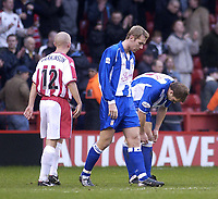 Photo. Glyn Thomas.<br /> Sheffield United v Colchester. FA Cup fifth round.<br /> Bramall Lane, Sheffield. 15/02/2004.<br /> Colchester's Liam Chilvers (C) leaves the field dejectedly after his side is defeated.