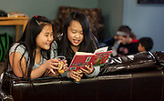Children have a snack and read in an after school program called the Homework Club. (Photo © Andy Manis)