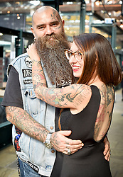 © licensed to London News Pictures. 25/09/2015<br /> The 11th London International Tattoo Convention, one of the most prestigious body art conventions in the world, brought together 400 of the best tattoo artists to thousands of admirers at Tobacco Dock. Other attractions and alternative performances included burlesque, sword swallowing, striptease dancers, fire-dancers and trapeze performers. Pictured Tattoo fans George and Michelle from Italy.<br /> Photo credit : Ian Whittaker/LNP
