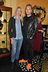 SEB & HEIDI BISHOP at a lunch to view Solange Azagury-Partridge's new collection - Chromance at her store at 5 Carlos Place, London on 7th October 2014.