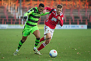 Forest Green Rovers Keanu Marsh-Brown(7) and Wrexham's Jordan Evans during the Vanarama National League match between Wrexham FC and Forest Green Rovers at the Racecourse Ground, Wrexham, United Kingdom on 26 November 2016. Photo by Shane Healey.