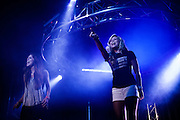 TRUSSVILLE, AL - AUGUST 27, 2013: Hannah McDaniel (left) and Kate Welch (right) perform a drama at The Basement, a Christian youth ministry in Alabama that is widely known for its club atmosphere and large crowds. The Basement was founded in 2004 by Matt Pitt, a former drug dealer turned evangelist who began organizing worship services in his basement after abandoning a life of drugs. Pitt was arrested on August 20, 2013 for impersonating a police officer, and the Tuesday night gathering was the first to be held since his incarceration. CREDIT: Bob Miller for The New York Times.