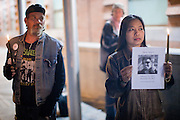"""04 JANUARY 2012 - PHOENIX, AZ:     KEN ALANDT (left) and LOVELY DYSON during a vigil for Marty Atencio in front of the Maricopa County Jail in Phoenix on January 4. Atencio died in a Phoenix hospital on Dec 20, 2011. He was arrested by Phoenix police a few days earlier after he exhibited """"bizarre"""" behavior on the street. He was booked into the Maricopa County Jail. During the booking process he was tackled by Maricopa County Detention Officers and repeatedly hit was a Taser stun gun. He was later found unconscious in a holding cell and transferred to a hospital, where he died four days later. An autopsy showed no signs of illegal drugs or intoxication and a video from the jail showed that Atencio was not violent in the jail. His family has hired a lawyer and may sue the Maricopa County Sheriff's Department, which administers the jail.   PHOTO BY JACK KURTZ"""