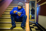 Breakfast on the stairs at Slough Homeless our concern (SHOC) A local homeless charity helping the homeless and vulnerable in Slough. Berkshire, UK.