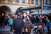A small crowd looking at The Prague Astronomical Clock or Prague Orloj which is a medieval astronomical clock attached to the Old Town Hall in Prague at Old Town Square. On March 1st, 2021 the state of emergency in the Czech Republic was reinstalled because of fast increasing numbers in infections. The lockdown was reinstated and the restriction of the free movement of people has taken effect. Currently, the country remains at the highest stage of the anti-epidemiological system and the newly imposed restriction will last at least three weeks to curb the epidemic.
