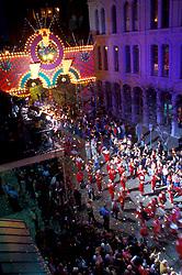 Night time Mardi Gras parade on the Strand in Galveston Texas