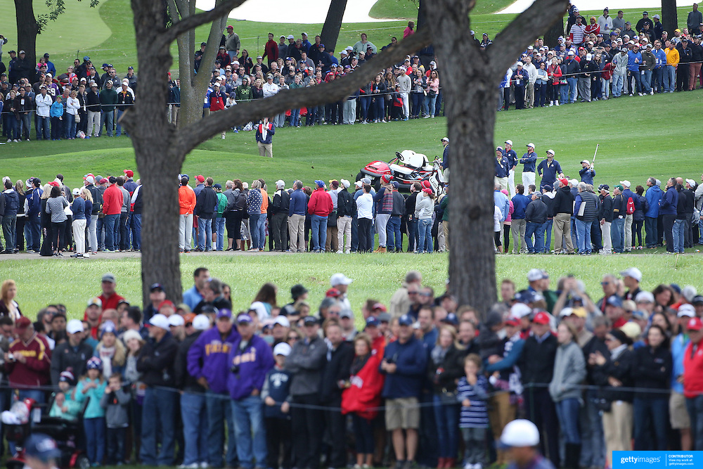Ryder Cup 2016. The United States group of J.B. Holmes, Zach Johnson, Ryan Moore and Brandt Snedeker play their approach shots onto the 16th green during practice day in front of massive crowds at the Hazeltine National Golf Club on September 28, 2016 in Chaska, Minnesota.  (Photo by Tim Clayton/Corbis via Getty Images)