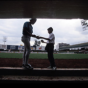 MEXICO CITY, MEXICO: A player for the Saltillo Saraperos signs an autograph for a fan before a game in Mexico City.