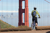 Young man mountain biking the Marin Headlands, Golden Gate National Recreation Area. San Francisco,  CA