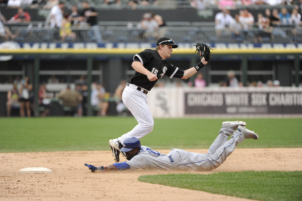 CHICAGO - MAY 22:  Gordon Beckham #15 of the Chicago White Sox catches the throw from the catcher as Tony Gwynn Jr. #10 of the Los Angeles Dodgers steals second base on May 22, 2011 at U.S. Cellular Field in Chicago, Illinois.  The White Sox defeated the Dodgers 8-3.  (Photo by Ron Vesely)  Subject:   Gordon Beckham;Tony Gwynn Jr.