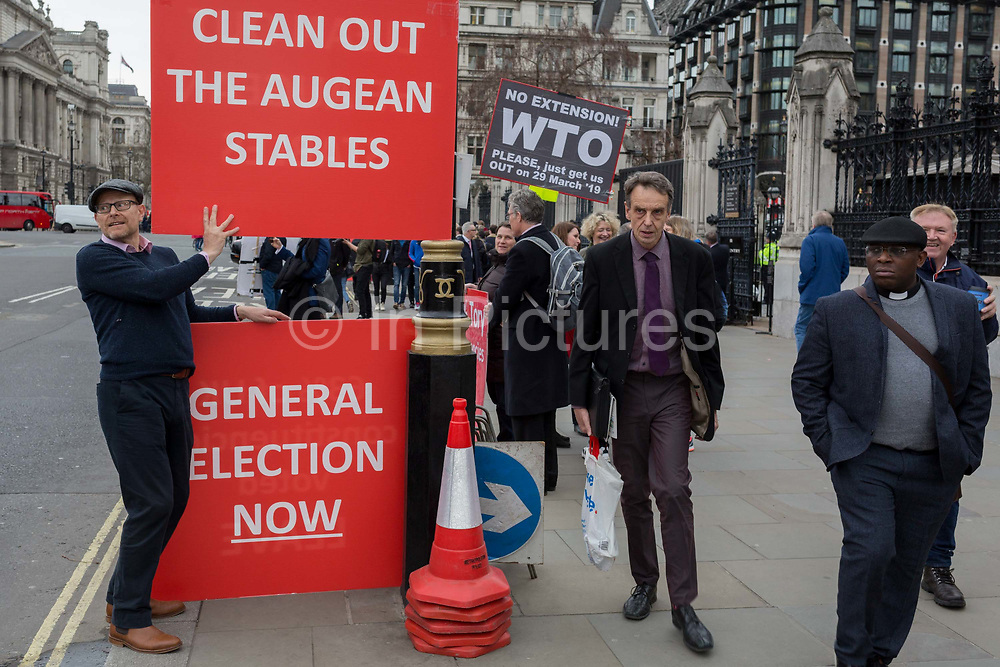 A day after Commons Speaker John Bercow announced his refusal to accept Prime Minster Theresa Mays third Brexit Meaningful Vote, a Brexiteer holds a sign that refers to the stables in which the mythical Argonaut King Augeas kept 3000 oxen, and which had not been cleaned for 30 years. The cleaning of these stables was accomplished by Hercules, on 19th March 2019, in London, England.