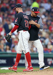 October 6, 2017 - Cleveland, OH, USA - Cleveland Indians starting pitcher Corey Kluber exits game against the New York Yankees in the third inning dring Game 2 of the American League Division Series, Friday, Oct. 6, 2017, at Progressive Field in Cleveland. At right is Indians manager Tito Francona. (Credit Image: © Phil Masturzo/TNS via ZUMA Wire)