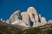 """See Mount Fitz Roy (3405 m or 11,171 ft elevation) and Aguja Guillaumet (left) from the trail to Lago Pollone. We hiked the scenic Rio Electrico Valley to Refugio Piedra del Fraile (""""Stone of the Friar"""", 14.5 km round trip) where we slept overnight in a basic 4-person dorm room. We carried sleeping bags to use on their pads. From the refuge, a rewarding day hike visits Lago Pollone (8.5 km round trip with 320 m gain) beneath towering Cerro Fitz Roy and Aguja Pollone. El Chalten, Santa Cruz Province, Argentina, Patagonia, South America. Monte Fitz Roy is also known as Cerro Chaltén, Cerro Fitz Roy, or Mount Fitz Roy. The first Europeans recorded as seeing Mount Fitz Roy were the Spanish explorer Antonio de Viedma and his companions, who in 1783 reached the shores of Viedma Lake. In 1877, Argentine explorer Francisco Moreno saw the mountain and named it Fitz Roy in honour of Robert FitzRoy who, as captain of HMS Beagle, had travelled up the Santa Cruz River in 1834 and charted large parts of the Patagonian coast. Mt Fitz Roy was first climbed in 1952. Cerro is a Spanish word meaning hill, while Chaltén comes from a Tehuelche word meaning """"smoking mountain"""", due to clouds that usually form around the peak."""