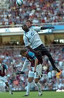 Photo: Tony Oudot.<br /> West Ham United v Wigan Athletic. The FA Barclays Premiership. 25/08/2007.<br /> Emile Heskey of Wigan climbs above George McCartney and Matthew Upson of West Ham