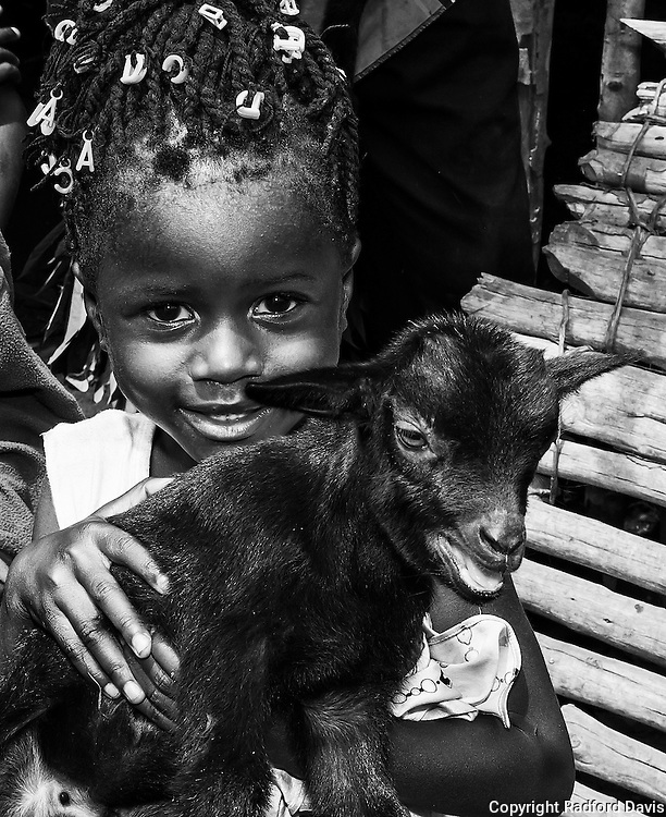 Children in the village of Mabamboo, about an hour and a half outside of Freetown, show off their goats that Heifer International has provided. The animals are a source of pride, and a bank account in hard times.