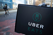 UberEATS delivery bike box in London, England, United Kingdom. Uber Eats is an on-demand meal delivery service powered by the Uber app. It is one of the first expansion products by Uber Technologies Inc., the technology platform that connects drivers and riders, and utilizes its existing network to deliver meals in minutes. The online food ordering service partners with local restaurants in selected cities around the world and allows customers to order meals using the Uber smartphone application. Delivery time is claimed to be 10 minutes or less.