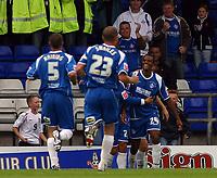 Photo: Paul Thomas.<br /> Oldham Athletic v Swansea City. Coca Cola League 1. 12/08/2006.<br /> <br /> Maheta Molango (24) celebrates his goal with Oldham team mates.