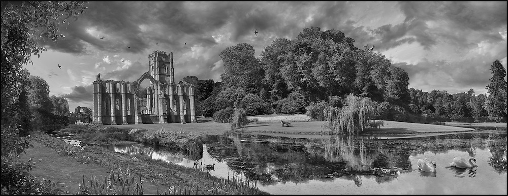 Fountains Abbey & Studley Royal water gardens, founded in 1132, is one of the largest and best preserved ruined Cistercian monasteries in England. The ruined monastery is a focal point of England's most important 18th century Water, the Studley Royal Water Garden which is a UNESCO World Heritage Site. Near Ripon, North Yorkshire, England .<br /> <br /> Visit our LANDSCAPE PHOTO ART PRINT COLLECTIONS for more wall art photos to browse https://funkystock.photoshelter.com/gallery-collection/Places-Landscape-Photo-art-Prints-by-Photographer-Paul-Williams/C00001WetsxVxNTo