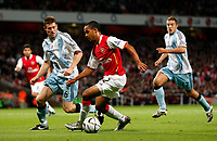 Photo: Richard Lane/Sportsbeat Images.<br />Arsenal v Newcastle United. Carling Cup. 25/09/2007. <br />Arsenal's Theo Walcott attacks as Newcastle's James Milner (lt) traces back.