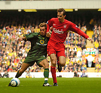 Fotball<br /> England 2004/2005<br /> Foto: SBI/Digitalsport<br /> NORWAY ONLY<br /> <br /> Liverpool v Norwich City, Barclays Premiership, 25/09/2004.<br /> Norwich's Darren Huckerby (L) tries to hold off Liverpool's Dietmar Hamann