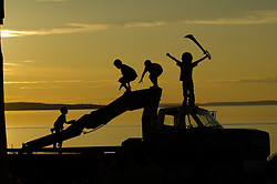 Villagers from the Dene' First Nation enjoy a sunset in Lutsel K'e (aka Snowdrift) July 22, 2011 in the Northwest Territories of Canada.