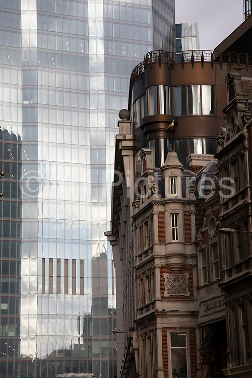 Old and new architecture in the City of London with older classical Leadenhall Market building and the modernism of 100 Bishopsgate 16th January 2020 in London, England, United Kingdom. As the financial district grows in height, the architecture has changed the face of London with many different companies occupying the various floors and levels, some of which remain empty as overseas investments.