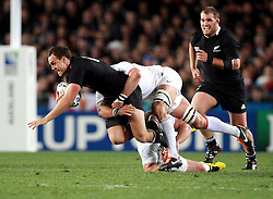 © Andrew Fosker / Seconds Left Images 2011 - New Zealand's Israel Dagg is knocked off his feet by a France's Lionel Nallet tackle - France v New Zealand - Rugby World Cup 2011 - Final - Eden Park - Auckland - New Zealand - 23/10/2011 -  All rights reserved..