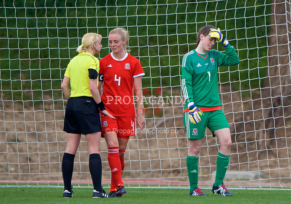 LARNACA, CYPRUS - Friday, March 2, 2018: Wales' captain Sophie Ingle complains to referee Anastasiya Romanyuk after a penalty is awarded during the Cyprus Women's Cup Group A match between Wales and Italy on day four of the Cyprus Cup tournament at the GSZ Stadium Stadium. (Pic by David Rawcliffe/Propaganda)