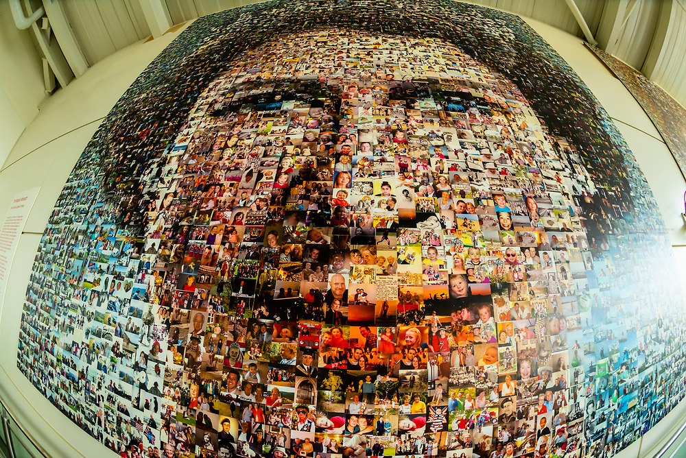 "On display at London Gatwick Airport is a BBC South East Jubilee Art Project titled ""The People's Monarch."" It uses thousands of photos submitted by viewers that creates two large scale photo mosaics, by artist Helen Marshall. One portrait was taken around her coronation and the second is a more contemporary portrait of her."