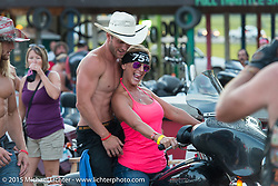 Photo Ops with bar tenders at the Full Throttle Saloon during the 75th Annual Sturgis Black Hills Motorcycle Rally.  SD, USA.  August 1, 2015.  Photography ©2015 Michael Lichter.