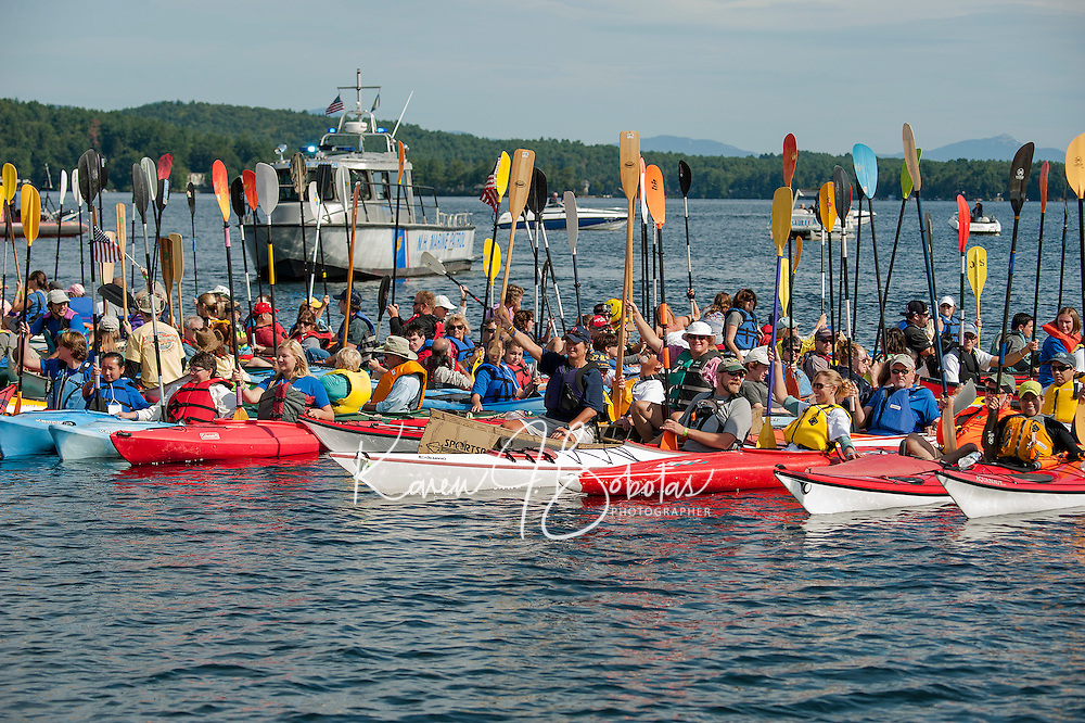 Lake Fest participants gather together just prior to their attempt at the Guinness World Record on Saturday morning in Lake Winnipesaukee off Weirs Beach.  (Karen Bobotas/for the Laconia Daily Sun)