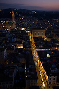 The commercial and shopping street Via de Calzaioli plus rooftops and housing seen in early evening of city of Florence seen from Giotto's Bell Tower (campanile). In the background is the fortress palace called the Palazzo Vecchio. Florence (Firenze) is the capital city of the Italian region of Tuscany and of the province of Florence. It is the most populous city in Tuscany, with 367,569 inhabitants (1,500,000 in the metropolitan area). The city lies on the River Arno and is known for its history and its importance in the Middle Ages and in the Renaissance, especially for its art and architecture. A centre of medieval European trade and finance and one of the wealthiest cities of the time, Florence has been called the Athens of the Middle Ages.