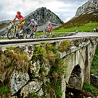 Spain, Lagos de Covadonga, 07-09-2014.<br /> Cycling, La Vuelta'14.<br /> Stage 15 from Oviedo to Lagos de Covadonga, 152,2 km.<br /> Alberto Contador from Spain in his Red Leader Jersey on 600 meters before the finih line followed by Alejandro Valverde and Joaquin Rodriguez in the Natural Park Lagos de Covadonga.<br /> Photo: Klaas Jan van der Weij