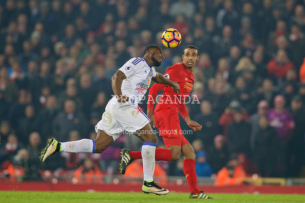 LIVERPOOL, ENGLAND - Saturday, November 26, 2016: Sunderland's Victor Anichebe in action against Liverpool's Joel Matip during the FA Premier League match at Anfield. (Pic by David Rawcliffe/Propaganda)