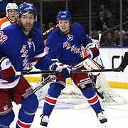 Derek Dorsett, (centre), New York Rangers, in action during the New York Rangers Vs Philadelphia Flyers, NHL regular season game at Madison Square Garden, New York, USA. 26th March 2014. Photo Tim Clayton