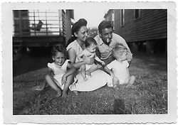 1950 Collect photograph; New Orleans, Louisiana.<br /> The Lajaunie family - ref Gayle Benson.<br /> Children L/R; Gayle, Brenda and Wayne<br /> Parents; Marie and Francis<br /> Gayle Benson (nee Lajaunie is at left of photo) was raised in humble surroundings. Gayle is the 3rd and current wife of Louisiana billionaire Tom Benson, owner of the NFL football team The New Orleans Saints and NBA basketball team The New Orleans Pelicans. <br /> Photo; Collect photo/varleypix.com