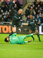 Football - 2017 / 2018 Premier League - Swansea City vs. West Bromwich Albion<br /> <br /> David Silva of Manchester City collides with Lukasz Fabianski of Swansea City, at The Liberty Stadium.<br /> <br /> COLORSPORT/WINSTON BYNORTH