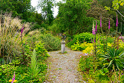 Sun dial in walled garden at Achamore Gardens on Isle of Gigha, Kintyre peninsula, Argyll & Bute, Scotland, UK