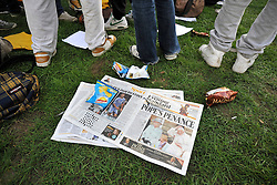 CENTRAL LONDON. A copy of the Evening Standard news paper lies on the grass.  Crowds of Londoners, visitors and pilgrims visit London for the visit of Pope Benedict XVI on 17/18th September 2010. It is estimated that 80,000 people will flock to see the Pontiff during his visit to the capital. 18th September 2010.STEPHEN SIMPSON.