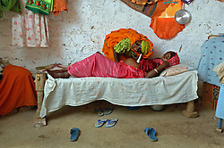 Kadija visits Fatna Adem, 28, just a few days before she helped her give birth to a baby girl in a village in Barentu, Eritrea August 27 2006. They wait one week before they give the a child a name because child mortality is so frequent.